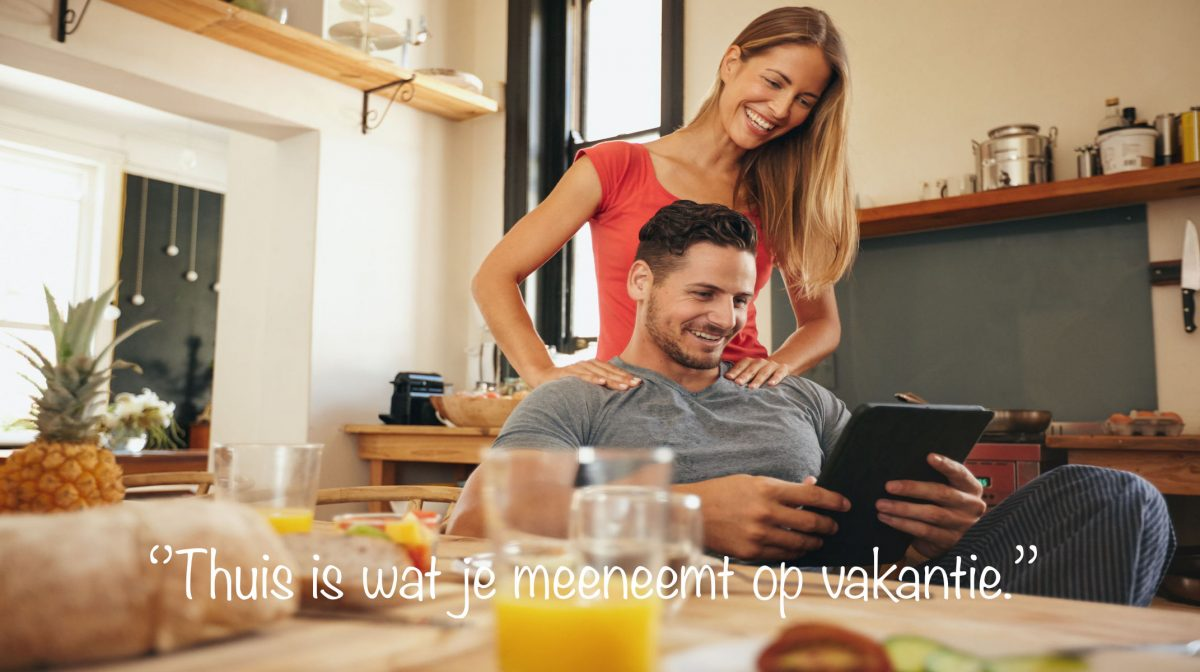 40257377 - shot of happy young man and woman using digital tablet in morning. couple using touchpad in kitchen smiling.